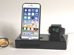 The CONCERT Tandem docking station provides a beautiful home base for both your iPhone and Apple Watch.  This  beautifully crafted docking station offers an acoustically amplified dock for your iPhone and a 'nightstand compatible' home for your Apple Watch, so you can gently wakeup with you