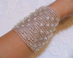 FREE SHIPPING!!!  Thank you for visiting my shop! This stunning bridal crochet cuff bracelet handmade out of high quality non tarnish silver plated wire with some lovely crystals. It has got a magnetic clasp. This classy bracelet will complete the bridal outfit in so special day. The bracelet is created using a very thin crochet hook in unique technique. This design is double layered, but also very light and comfy .This piece is 2,6/8(7cm) wide and approx. 7,1 (18 cm) lenght ,but you can…