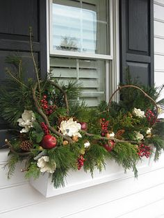 Winter window box....just add tiny white lights and they're beautiful at night as well.