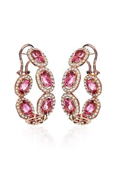 "Pink extravagance... Haute Vault's 18K rose gold in and out hoops features pink tourmalines surrounded by diamonds. These feminine beauties are a treat from every angle that will take your evening look from great to sensational! Measures 1 1/4"" long b y 7/8"" wide"