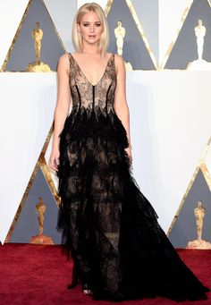 2016 Oscars | Jennifer Lawrence wears a bold lingerie-inspired and multi-tiered Dior Haute Couture gown with Chopard jewelry | photo credit: Jeff Kravitz/FilmMagic