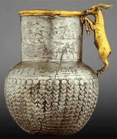 Silver Vessel with Gold Goat Handle. Sanctuary of Goddess Bastet.  Inscribed as belonging to the royal cupbearer, 'butler' and messenger - Atumentyneb. A cupbearer's job was to protect royalty from poison. after 1290 BCE. Egyptian Museum.