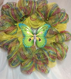 "Butterfly wreath. 7"" blue, green, yellow, pink metal butterfly. Pink, green, blue, yellow stripe & yellow mesh, 16"" wire frame. 20""  wreath by KhQualityCreations on Etsy"