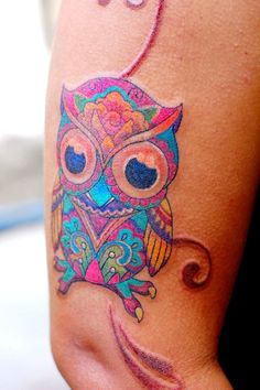 Splendid owl watercolor tattoo on arm for woman