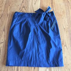 Elie Tahari navy skirt w/tie waist- front pockets Size 10 Elie Tahari skirt. Tie front. Pockets on each side of the front. New. Bought at Neiman Marcus Elie Tahari Skirts