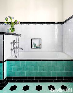 The Sunrise Specialty tub is fitted with THG fixtures. Tiles by Mission Tile West. Paint is Benjamin Moore Aura Bath & Spa in Niveous.   - HouseBeautiful.com