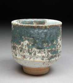 Handmade Stoneware Yunomi Tea Cup Glazed with Shino, Wood Ash and Copper made by D Michael Coffee at Shyrabbit Studios.  Added this one to my collection.