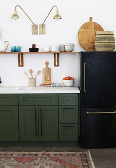 "The sleek black fridge is another DIY moment: It used to be handleless and stainless steel, believe it or not. ""When we started looking for a small fridge for the space, we realized that there just aren't very many good options out there,"" Jenny recalls. ""We were so happy with how our black-and-gold fridge turned out. It's super fun and totally elevates the space."""