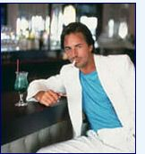Miami Vice 80s Costume Party Ideas - white suit, colored tee, two day stubble and some boss shades.