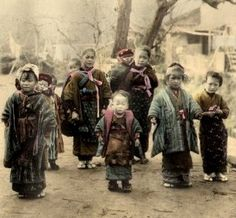 Rural children, some carrying babies, in Old Japan