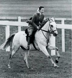 Great old photo of Queen Elizabeth galloping on Ascot racecourse - 1961 on her gray horse Surprise!