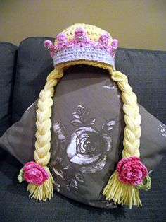 crochet princess hat with crown and braids - free pattern. Could modify for girls who love Frozen!!