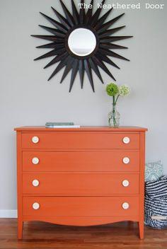 An Orange Milk Paint Dresser with Bone Knobs