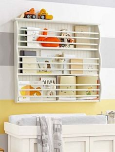 A shallow magazine rack can keep things organized (and off the floor).