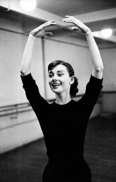 Audrey Hepburn with ballet coach Lucien Legrand, the first dancer and choreographer for the Paris Opera Ballet, at a dance rehearsal for her film Funny Face, Paris, France, 1956. Photographs by David Seymour.