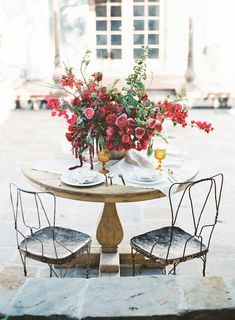 Red wedding centerpiece - modern wedding centerpiece for outdoor wedding Read more red wedding dress ideas on WeddingWire!