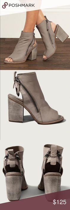 DOLCE VITA BOOTIES NIB SIZE 9.5 With an effortlessly cool approach to fashion, Dolce Vita masters a mix of casual and flirty styles. With a rock star worthy silhouette, the Port is a peep toe bootie featuring exposed zippers and a stacked wood heel. Dolce Vita Shoes Ankle Boots & Booties