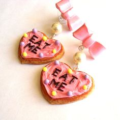 Alice in Wonderland Earrings Eat Me Earrings Kawaii Pink Bow Heart... (£27) ❤ liked on Polyvore featuring jewelry, earrings, bow earrings, lightweight earrings, heart jewelry, letter earrings and pink heart earrings