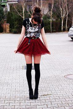Mickey shirt, black belt, lace skirt, knee highs.