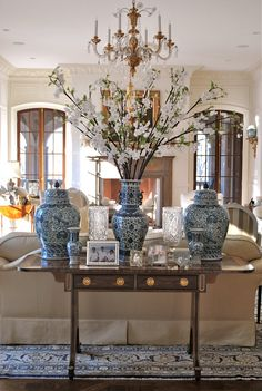 Chinoiserie blue and white ceramics in this rather traditional formal living room.