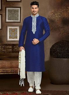 Charming blue and white festival wear dupion kurta pyjama. Having fabric dupion and art silk. This attire is nicely designed with embroidery work, stone work, resham embroidery work, zari work and thread work. Comes with matching bottom. Indian Fashion, Mens Fashion, Fashion Suits, Indian Wedding Wear, Indian Kurta, Dupion Silk, Groom Outfit, Sherwani, Indian Outfits