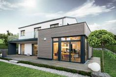 Fertighaus - GRIFFNERHAUS GmbH - CLASSIC München - 2-Giebel Garage Doors, New Homes, House Styles, Interior, Outdoor Decor, Room, Home Decor, Outdoors, Awesome