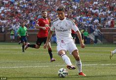 Second best: Real Madrid's Cristiano Ronaldo has been given a rating of 92 on FIFA 15...