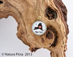 I love New York state map silhouette necklace by naturapicta, $12.95