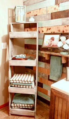 Top 10 DIY Bathroom Storage Solutions (i really just love the wood wall in this bathroom)