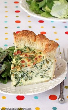 Cheesy Spinach & Bacon Puff Pastry Quiche Recipe ~ A cheesy quiche with ribbons of fresh spinach and crumbled bacon in a flaky puff pastry crust.