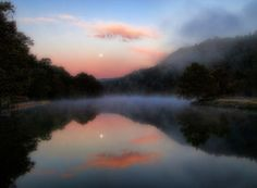 Dawn's early light creates an awe-inspiring scene at Beavers Bend State Park in Broken Bow, Oklahoma.