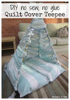 DIY no sew no glue quilt cover teepee. Easy to make using an old quilt or duvet cover. Create your own den, teepee or fort. Includes fairy lights for night time play.