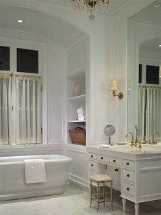 gorgeous white bathroom, built in shelves, free standing bath, vanity