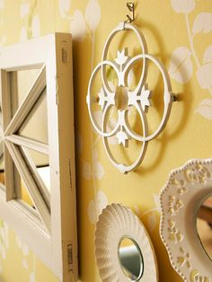"""Wall Accessories: """"Make your own artwork and accessories from vintage finds used in clever ways. Add mirrors to old windows and plate fronts for reflective art. Here, vintage pieces were painted white to create interesting wall art."""""""