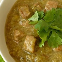 Crock Pot Green Chili Stew. I would choose 1 meat. Either pork or chicken would be best, I think.