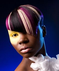 A short black straight coloured quirky avant garde Multi-Tonal Womens haircut hairstyle by asquared