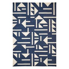 Designed exclusively by The Conran Shop, this Triangle Tile Dhurrie Rug in blue and ivory hues is handwoven and crafted from 100% cotton.