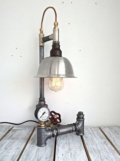 Table lamp. Made of steel, cast iron, brass, copper. Lampshade-alloy steel. Socket-E26/27. Power cord-1.5 m with swith on/off. Height-55 cm. Width-22 cm. Depth-25 cm. Electric parts are certified by the EU. An electrical plug adapter is required for use in the United States. Light bulb