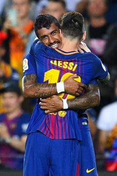 Paulinho of FC Barcelona celebrates with his team mate Lionel Messi after scoring his team's second goal during the La Liga match between Barcelona and SD Eibar at Camp Nou on September 19, 2017 in Barcelona, Spain.