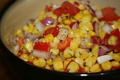 Fresh Corn Salad - Garden fresh corn, sweet bell peppers, tomatoes and some red onion, combine with a sweet and sour vinegar and oil dressing for a wonderful summer salad!