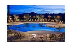Twilight reflects in a jewel-like pool. This Del Webb gated lifestyle community near Las Vegas appeals to all ages. With Fitness Center, basketball and tennis courts. Henderson, NV.