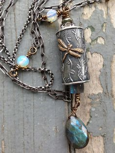 I am such a fan of artist Anne Chois beautiful oxidized sterling silver beads! This one has a gold Dragonfly on a willow print background. The