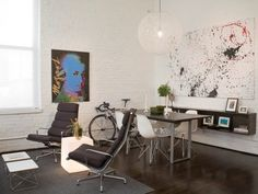 pop art + abstract art in a whitewashed brick room with modern furnishings