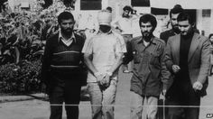 An American hostage being paraded before the cameras by his Iranian captors…