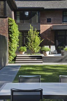 A modern brick home with an incredible backyard.