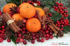 Cranberry and mandarin orange Christmas fruit with cinnamon and star anise spice, holly, mistletoe, ivy and snow covered fir. www.teelieturner.com #Christmas