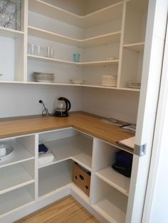 Pantry storage. Bottom pantry shelves a bit too deep it would be a hassle to