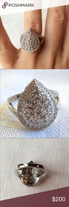 NWT Genuine Diamond & Crystal Teardrop Ring Sizes that are available: 5, 6, 7, 9, & 10. .01 ct TW genuine diamonds. Pear shaped ring. Brand new. Absolutely stunning ring in person! Rhodium over bronze. Comes with a red velvet drawstring bag and is also in a small ziploc protective bag. Host Pick Pretty, Flirty & Girly Party 11/23/15 ✨✨✨✨✨Two FIVE star ratings on this so far! Check my feedback! Jewelry Rings