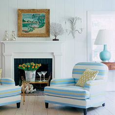 Benjamin Moore Iceberg 2122-50  A crisp, calm blue. Nice with white and a touch of black. Love the chair.