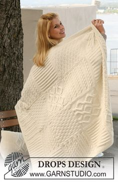 "Free pattern: Knitted DROPS blanket with squares in different structured patterns in ""Nepal""."